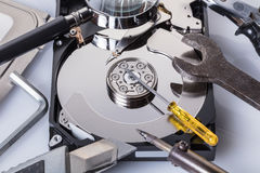Computer hard disk and tools Stock Photography
