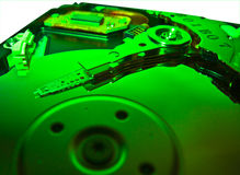 Computer Hard Drive - Green Technology. A clseup of a computer hard drive - green Royalty Free Stock Photo