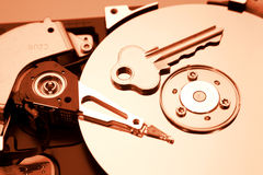 Computer hard drive and key Royalty Free Stock Image