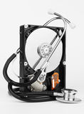 Computer hard drive and a stethoscope Royalty Free Stock Images