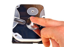 Computer hard drive and a stethoscope Stock Photography