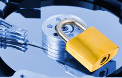 Computer harddrive and lock Stock Images
