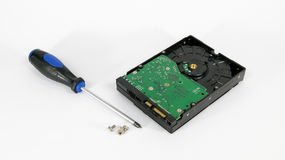 Computer hardisk drive with screws and screw driver isolated on Stock Photography