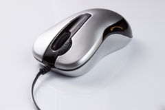 Computer hardware. Silver mouse on the white background Stock Photos