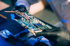 Computer hardware engineering motherboard. Computer hardware engineering. technology science concept. developer holding electronic motherboard royalty free stock photo