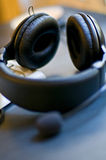 Computer Headset. Kept near a keyboard Royalty Free Stock Image