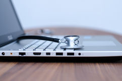 Computer health check. With a stethoscope royalty free stock photography