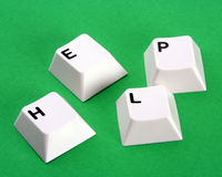 Computer help. Computer keys spelling help on green background Royalty Free Stock Images