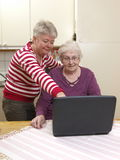 Computer help. An old women is getting help to understand her computer Stock Photo