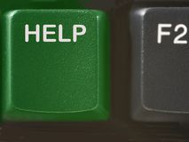 Computer help key in green colors Stock Photos