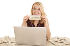 Computer hold money Royalty Free Stock Image
