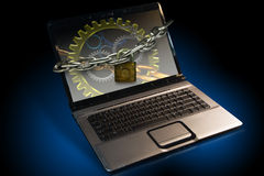 Computer ID Theft alert. Lap top note book Computer locked with chains Royalty Free Stock Photography