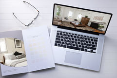 Computer Small Business Design. A still life with a laptop computer and paint sample brochure Stock Images