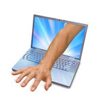 Computer Internet Hand Reach. A hand reaching out of a laptop computer screen isolated on a white background Royalty Free Stock Photos