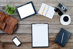 Computer ipad style and smart phone with isolated screens on old wooden desk Stock Photo