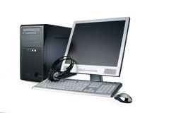 Computer isolated on white. A black case computer,with lcd monitor, keyboard, phones and mouse, isolated over white. Has clipping path Royalty Free Stock Photos