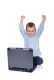Computer joy. Little boy winning computer game on laptop Royalty Free Stock Photos