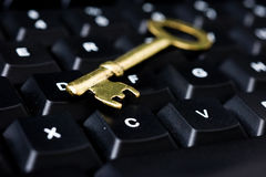 Computer with key Royalty Free Stock Images