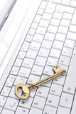 Computer with Key Stock Photography