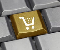 Computer key gold - shopping cart. Golden Computer key - shopping cart Stock Images