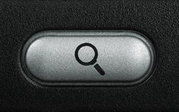 Computer key with magnifying symbol Stock Photos
