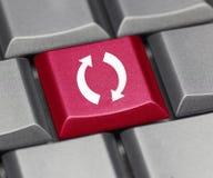 Computer key - Refresh symbol. Computer key red - Refresh symbol Royalty Free Stock Photos