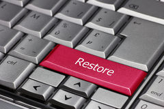 Computer key - Restore. Computer key coloured in red - restore Royalty Free Stock Photos