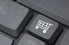 Computer keyboard. With a small shopping cart on button Royalty Free Stock Photos
