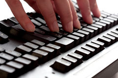 Computer keyboard. Typing fingers on a keyboard Stock Photos