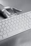 Computer keyboard aluminum silver hand Royalty Free Stock Photos
