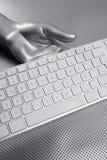 Computer keyboard aluminum silver hand royalty free stock photos