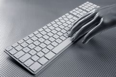 Computer keyboard aluminum silver hand Stock Photography