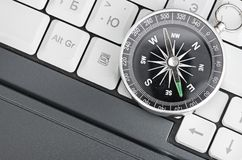 Computer Keyboard And Retro Compass Royalty Free Stock Photo