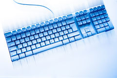 Computer keyboard in blue ambiance Stock Image