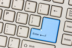 Computer keyboard with blue Enter key Stock Photo