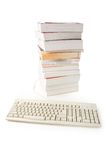Computer keyboard and book Royalty Free Stock Images