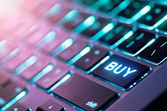 Computer keyboard with BUY button. Market activity, computer keyboard with BUY button stock images
