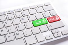 Computer keyboard with BUY and SELL bitcoin Stock Photos