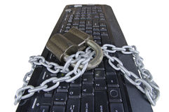 Computer  keyboard with chain and padlock Royalty Free Stock Images
