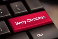 Computer keyboard with Christmas key. S - holiday concept Stock Photos