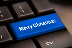 Computer keyboard with Christmas key. S - holiday concept Stock Image