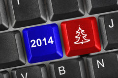 Computer keyboard with Christmas keys. Holiday concept Stock Photos