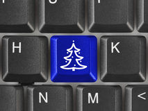 Computer keyboard with Christmas tree key Stock Photography
