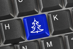 Computer keyboard with Christmas tree key Royalty Free Stock Photography