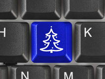 Computer keyboard with Christmas tree key Royalty Free Stock Photos