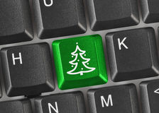 Computer keyboard with Christmas tree key Royalty Free Stock Photo