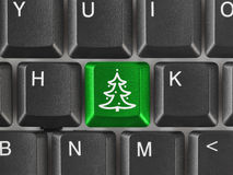 Computer keyboard with Christmas tree key. Holiday concept Royalty Free Stock Photos