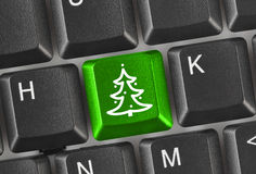 Computer keyboard with Christmas tree key Royalty Free Stock Image