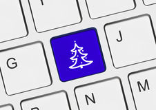 Computer keyboard with Christmas tree key Royalty Free Stock Images
