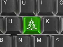 Computer keyboard with Christmas tree key Stock Images